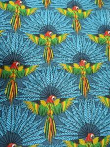 coton oeko tex perroquet sur fond bleu
